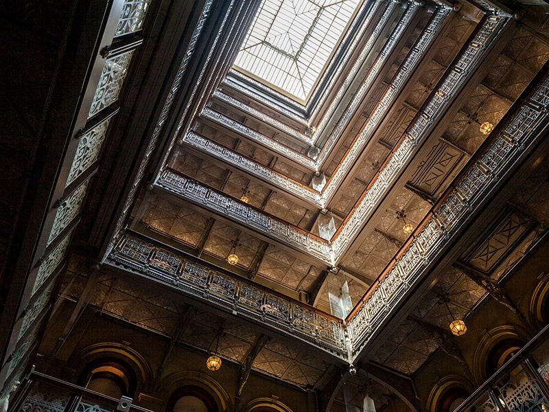 Show-stopping features of The Beekman's atrium include a pyramidal skylight and Victorian cast iron railings. Photograph: Richard Barnes