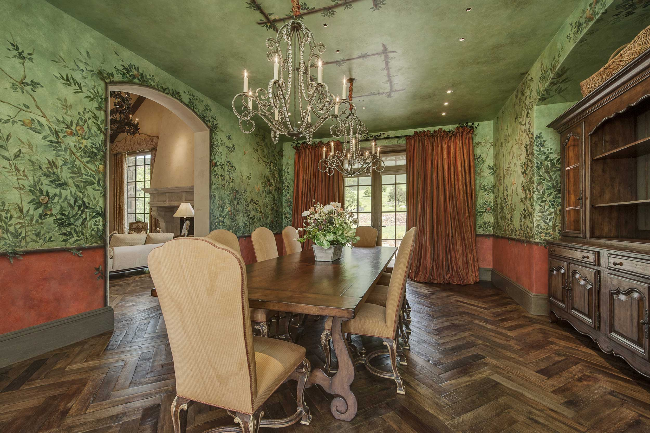"""This San Francisco home's dining room certainly embraces Pantone's concept of """"Greenery.""""  In addition to its fresh leaf-green hue, the room features a beautiful leaf mural, which combined with the natural timbered floors, evokes the atmosphere of an emerald forest."""