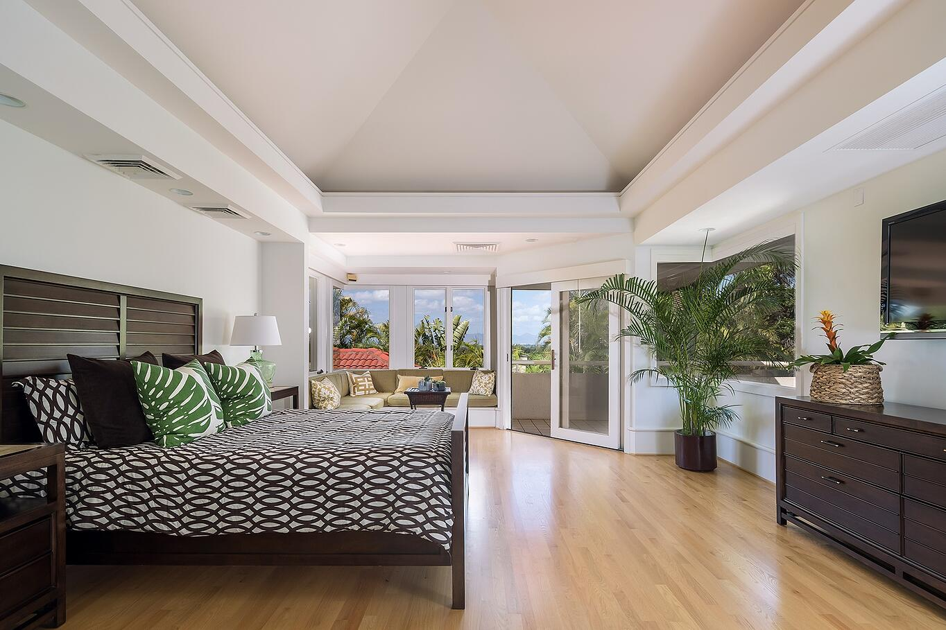 This master suite enjoys clean lines and an outdoor balcony. Photograph: Mark Singer Photography