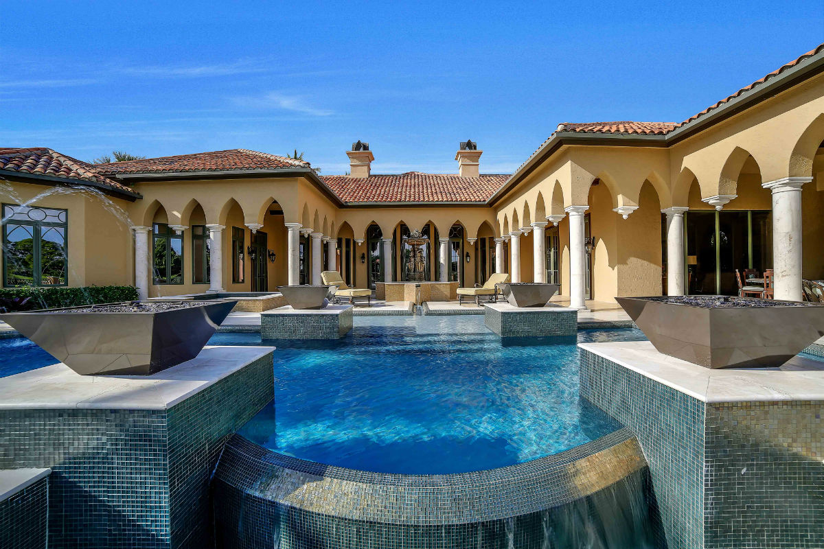 This Mediterranean-inspired resort villa was the recipient of South Florida's Sand Dollar Award for best kitchen remodel in the $1 million+ category.