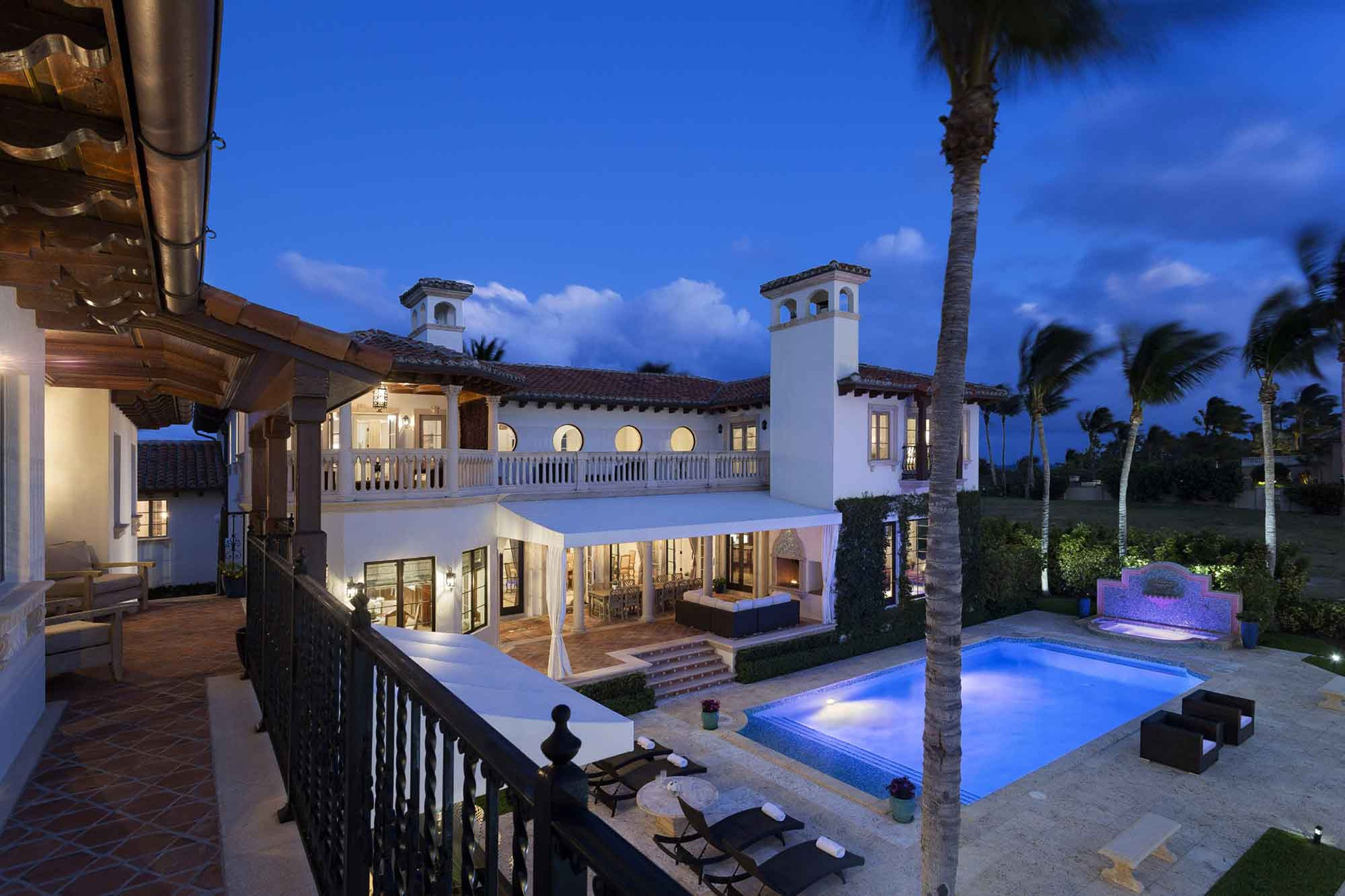 The magnificent oceanfront estate in Manalapan, Florida, features a club room with an onyx wet bar and piano, frequently played by the current homeowner, celebrated singer-songwriter Billy Joel.