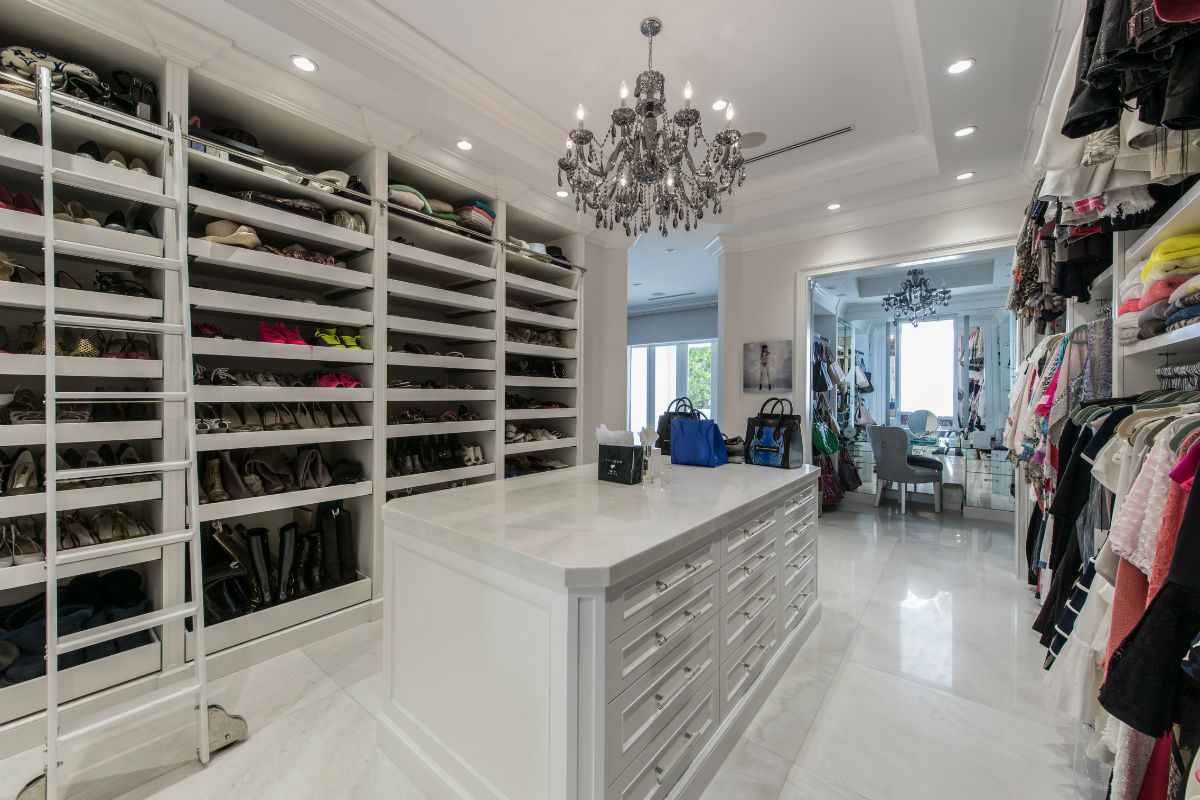 """For stylish living on the waterfront, this Miami Beach home's stellar amenities include a master suite with private terrace, """"pajama lounge"""" and custom-designed walk-in closet."""