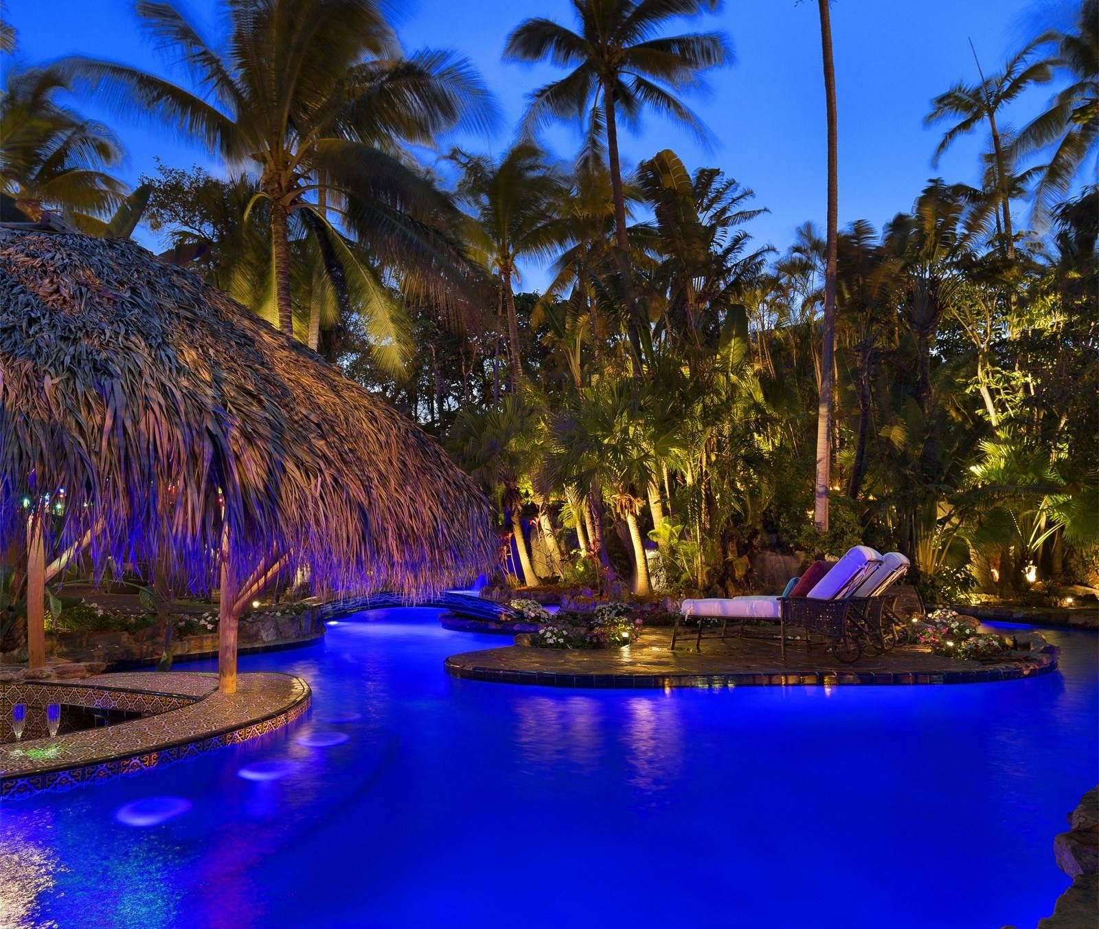 A swim-up bar, diving platforms, and grottos provide create a resort-style haven at this glamorous 1920s hideaway on Fort Lauderdale's New River.
