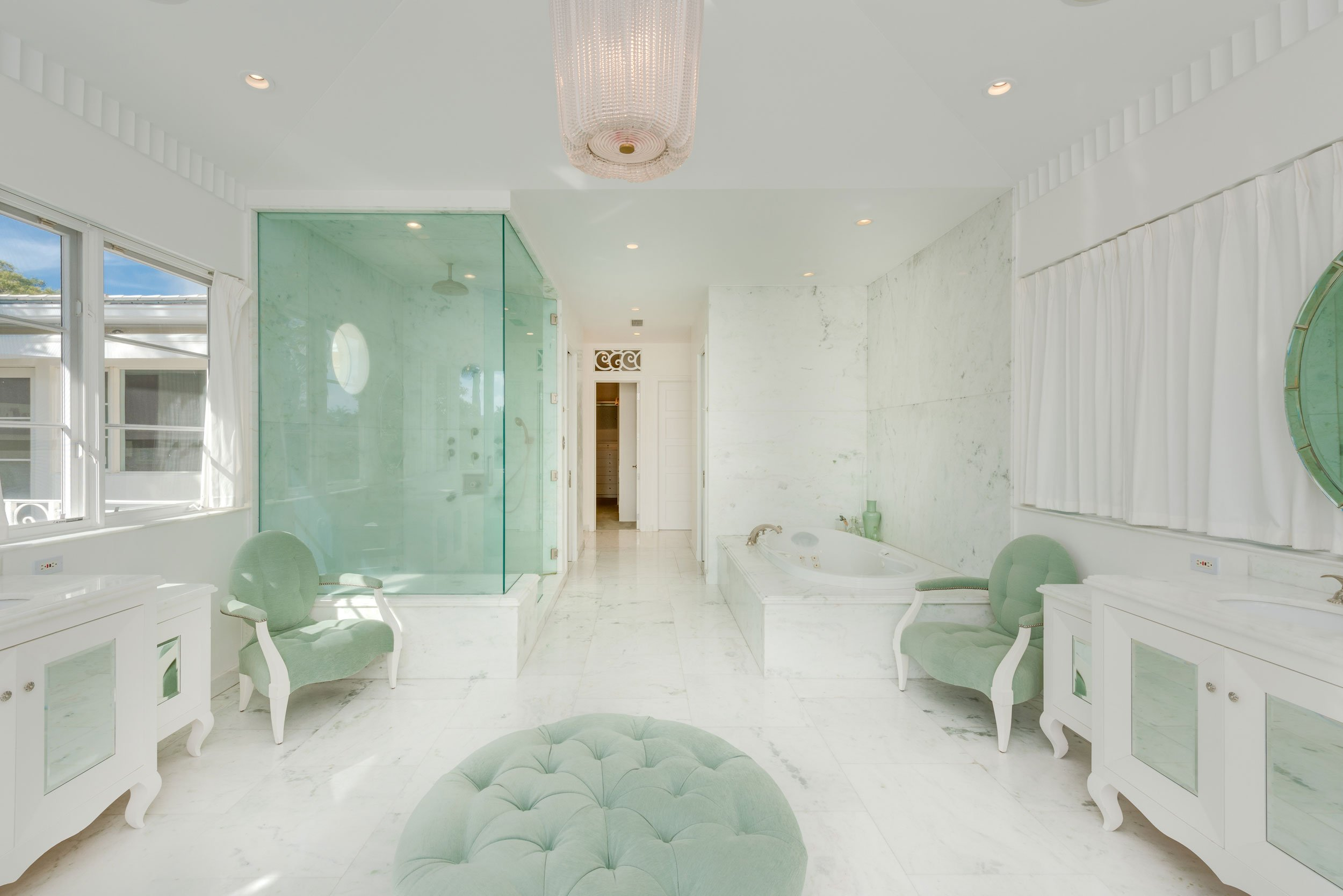 The Russell Pancoast Estate is a 1930s landmark in Miami Beach. The home's elegant master bathroom is like a jewel, accoutered in white marble with sea-green-hued furnishings.