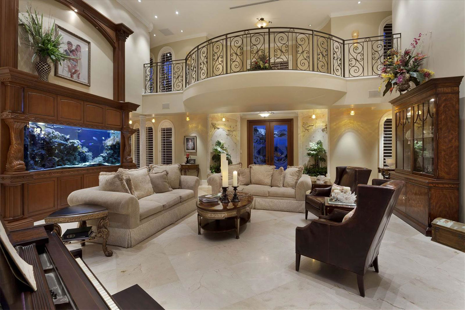 The theme of the sea is on constant display in this grand Mediterranean-style main residence. The saltwater aquarium provides a relaxing interlude in the magnificent two-story living room.
