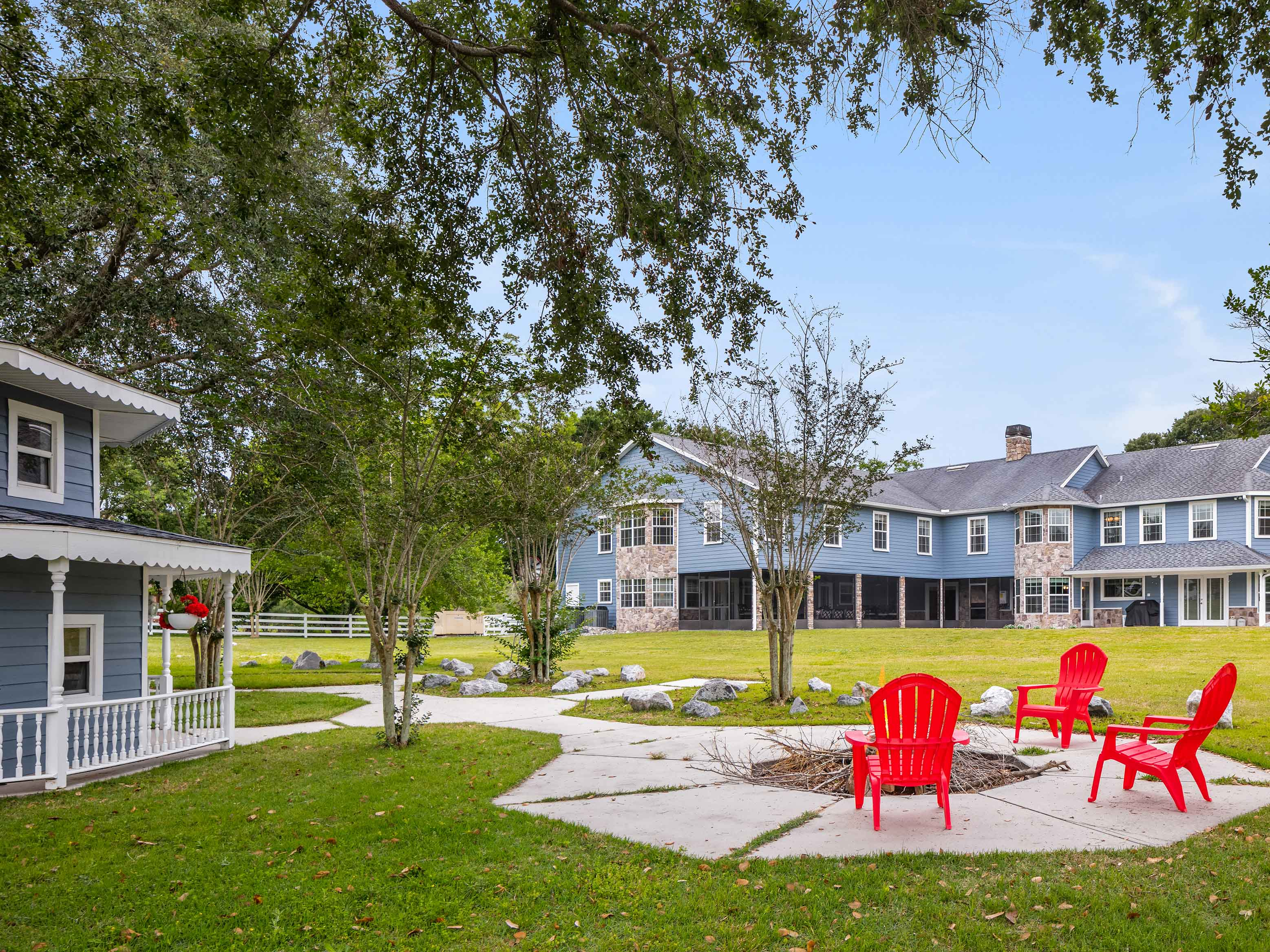 A two-story children's playhouse, equipped with electrics and air conditioning, and its own fenced backyard is just one of the star attractions of this Florida hobby farm.