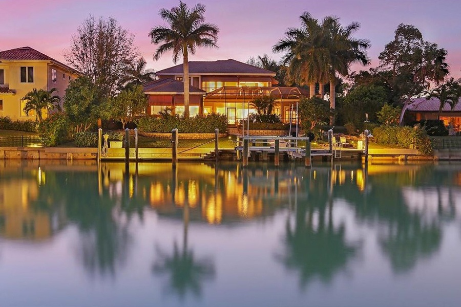 This waterfront estate in Sarasota's Bird Key is perched right on the Bay, and enjoys over 100 feet of water frontage, as well as a private boat lift.
