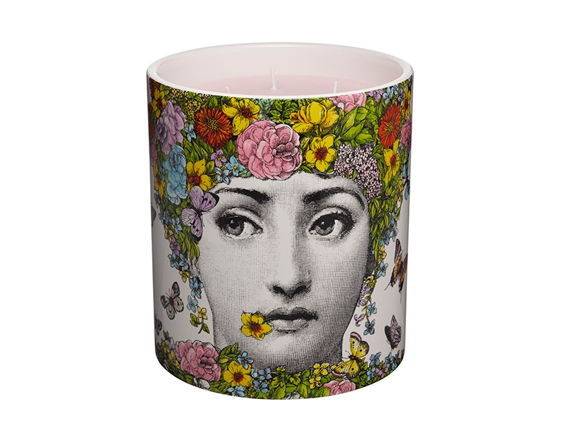 The Flora candle depicts Fornasetti's muse, the Italian opera singer Lina Cavalieri, in the guise of the mythical fertility goddess Flora.