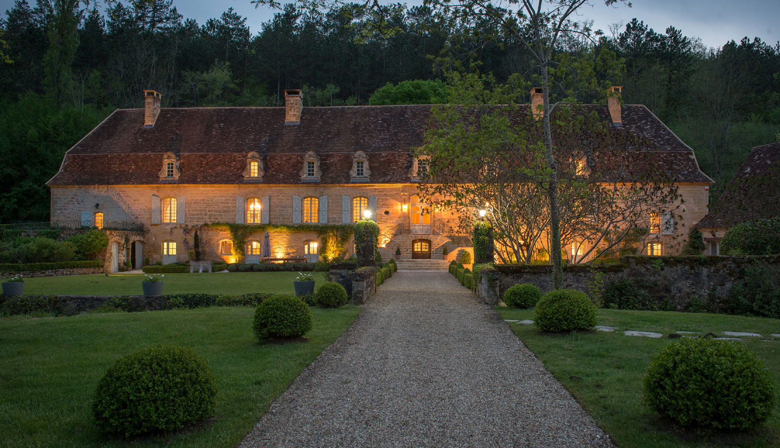 This magnificent 17th-century estate in the Dordogne region of France shines amid 182 acres of verdant parkland; adding to the splendor are several dwellings, a pool, fishing pond, and stream.