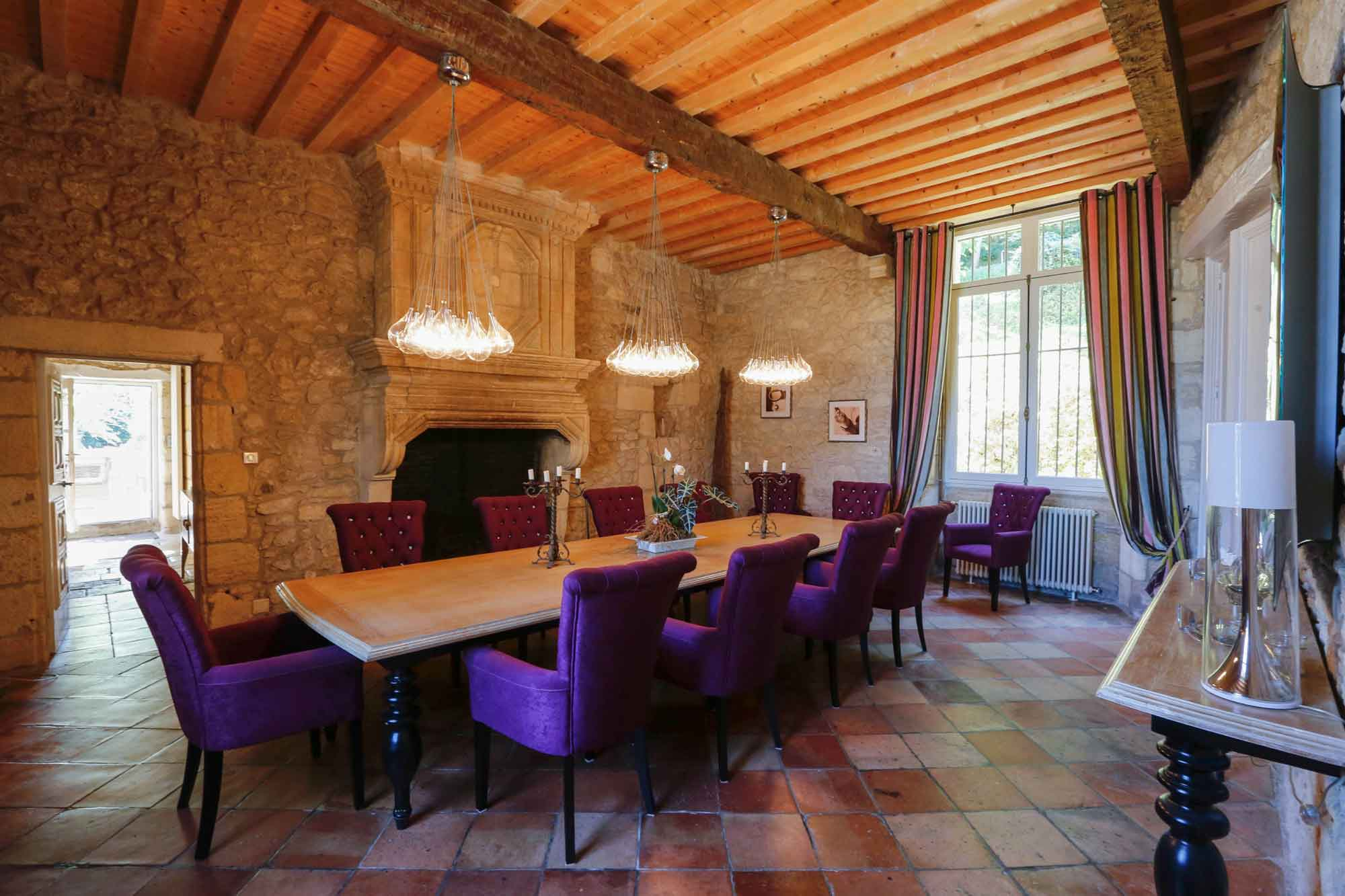 With a grand six-bedroom manor house, a two-bedroom cottage, and three-bedroom converted barn, this elegant 42-acre estate in France's Bergerac wine region is the ideal retreat for guests or extended family.
