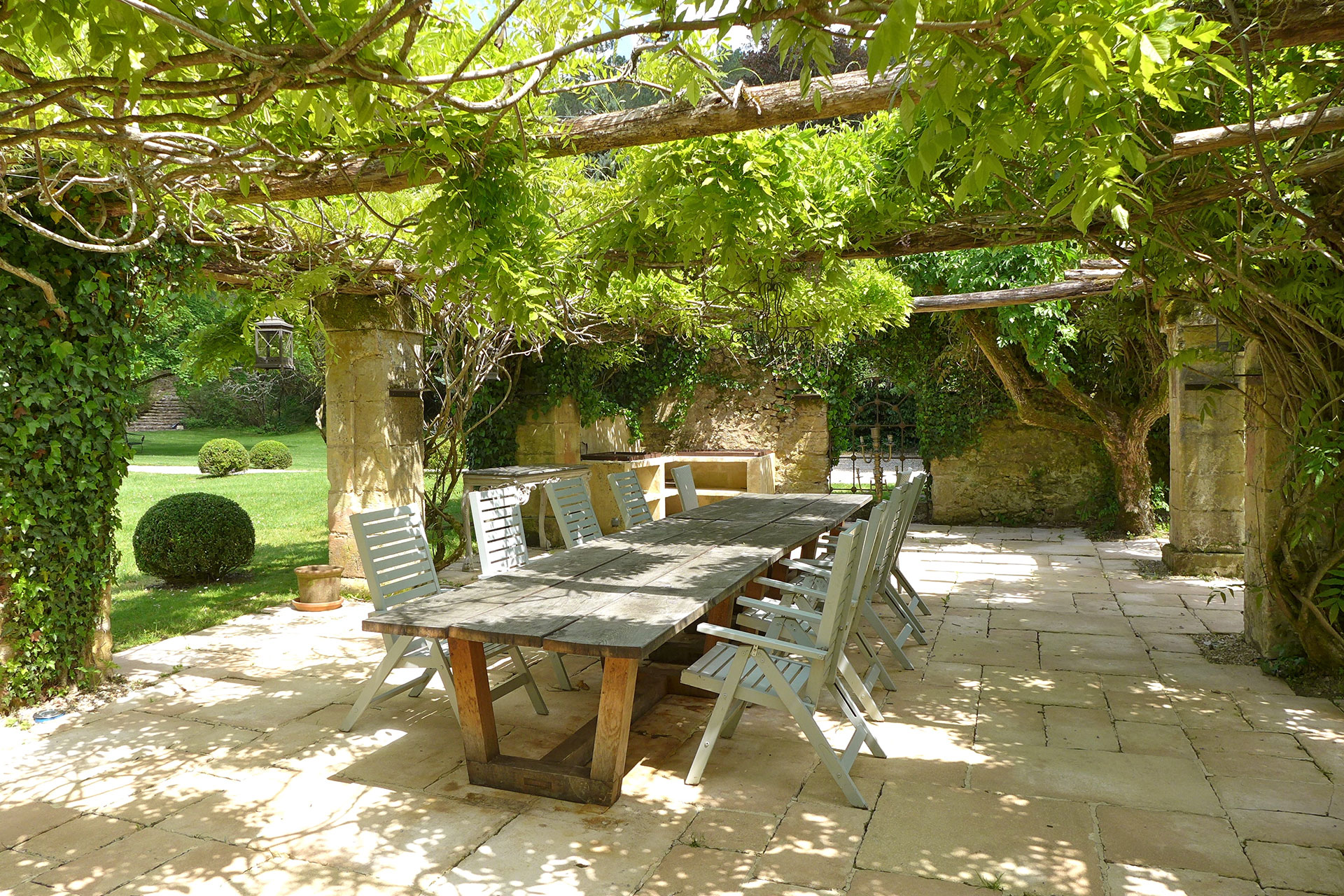 This 182-acre château estate in the Perigord region of the Dordogne features a courtyard garden with a dining terrace and fire pit from which to enjoy delightful summer evenings.