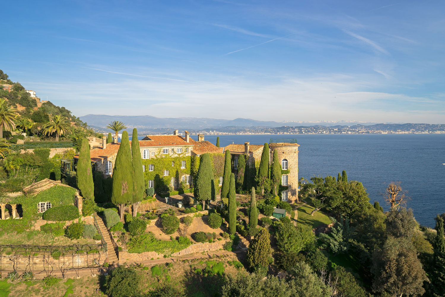 Near Cannes, France, this sublime 2.5-hectare waterfront estate commands a stunning panoramic view over the sea and harbor.