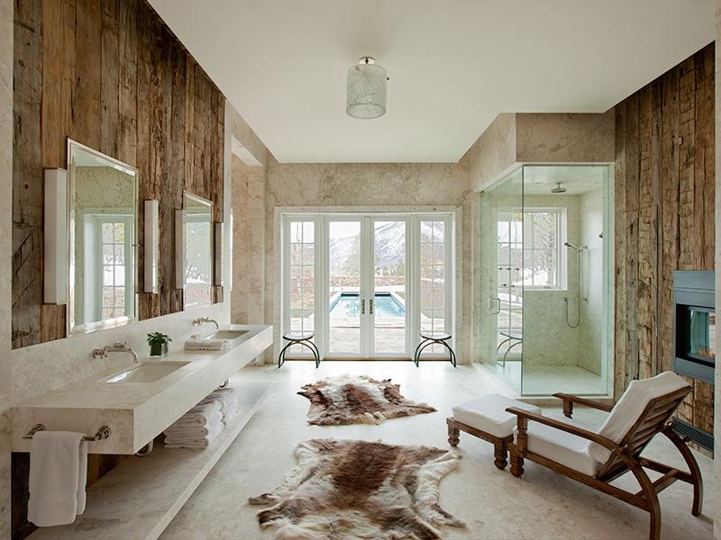 Biasi's love of natural materials is evident in this rustic-chic bathroom. Photograph: John Ellis