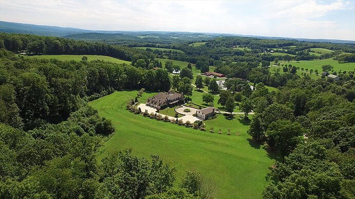 Evocative of the British sporting estate, this 504-acre Pennsylvania equestrian estate comprises a magnificent main house and equestrian barn with 15 stalls, run-in sheds, paddocks, fenced pastures, plus commercial-grade farm facilities.