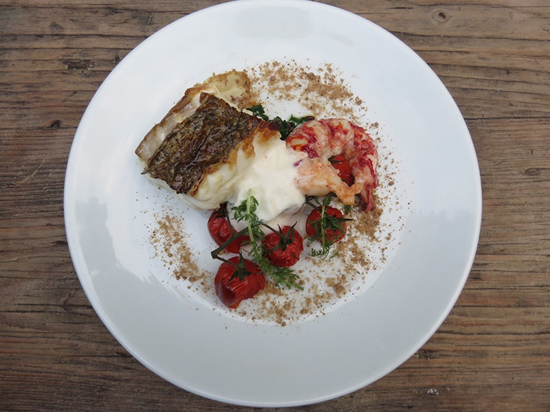 Dishes such as hake and lobster with smoked tomato and rye feature on the seasonal menu at The Gardener's Cottage.