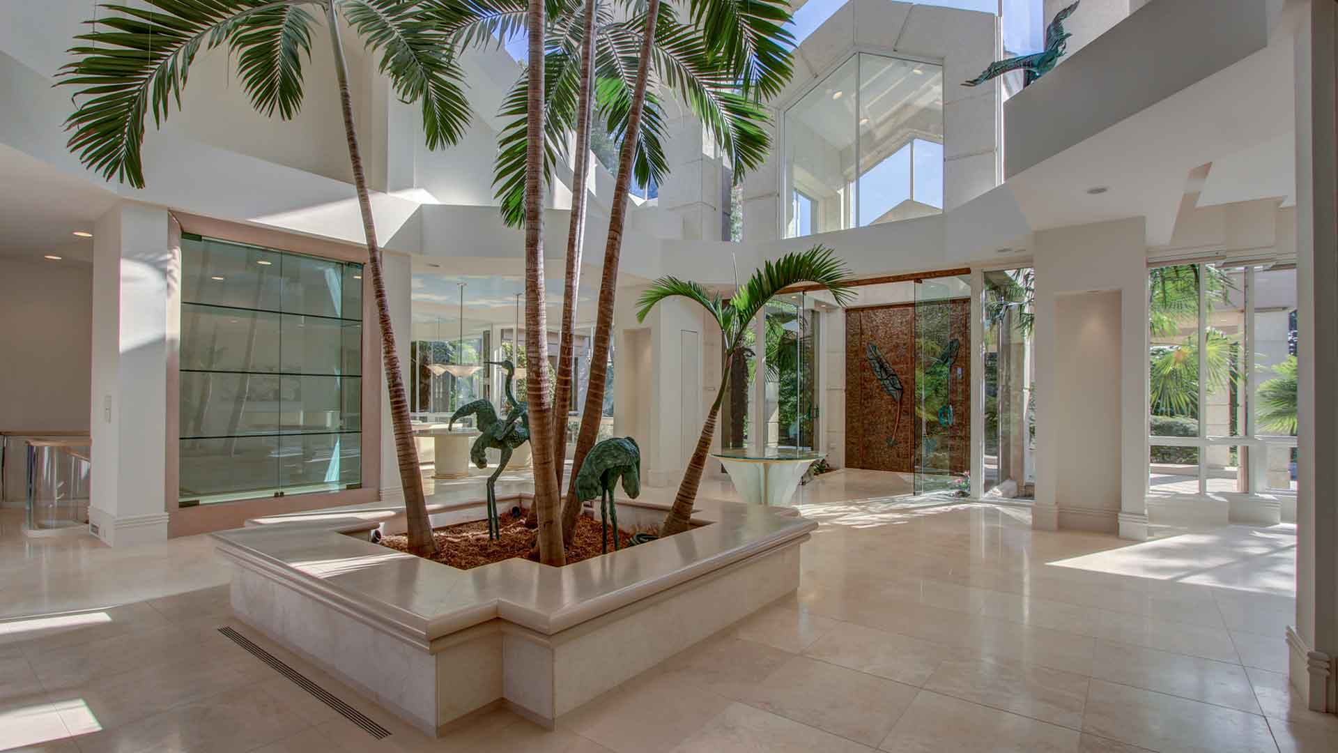The two-story atrium houses an exquisite palm court with marble floors and a glass ceiling.