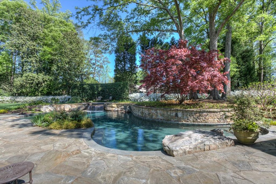 This beautifully landscaped and shaded saltwater pool, waterfall, and spa suggest long, relaxing afternoons luxuriating beside a private forest oasis.