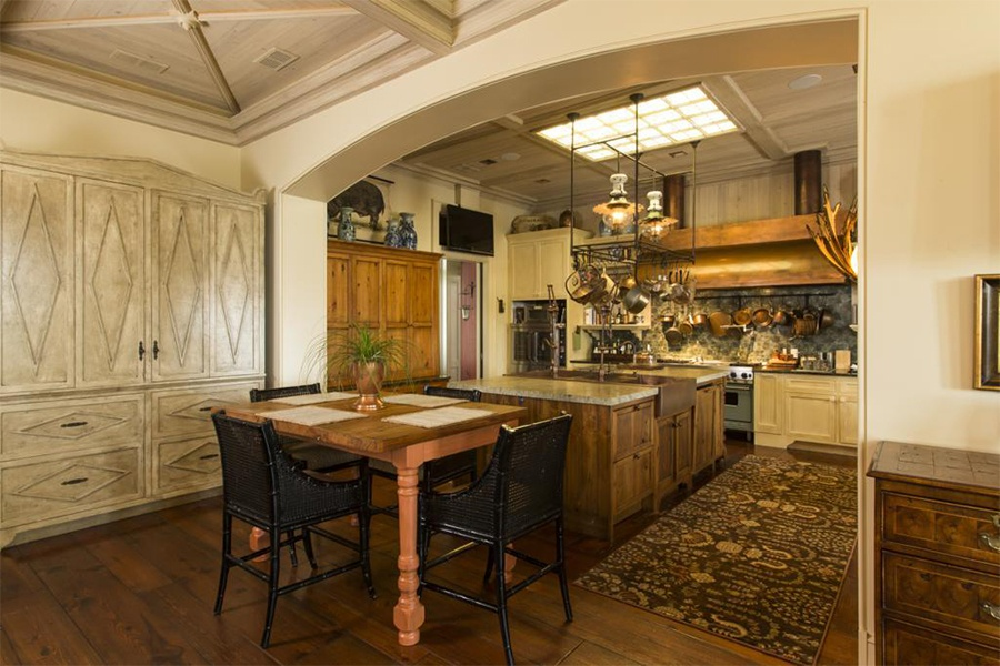 Relaxing family meals or grand, formal dinner parties are easy to realize in this open and airy Savannah kitchen with its warm wood cabinetry and cheerful skylight.