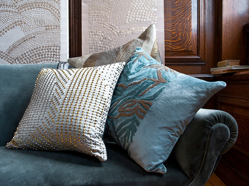 Larkin says the tactile quality of embroidery—a satin appliqué, an organza ribbon, metallic beadwork—is perfectly suited to soft furnishings. Photograph: Jooney Woodward