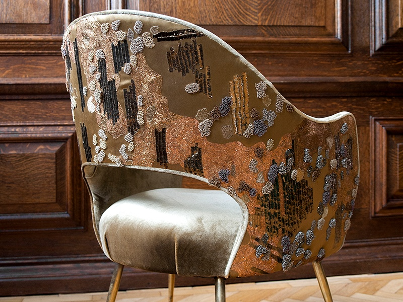 This midcentury chair was upholstered in gold velvet, and Larkin embroidered the back with gold flat-metal yarn, glass beads, French knots, and bullion loop. Photograph: Jooney Woodward