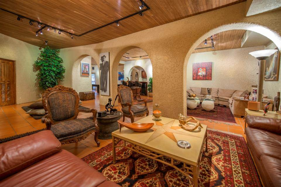 <b>4 Bedrooms, 22,066 sq. ft.</b><br/>Four-bedroom residence with high ceilings and lush gardens
