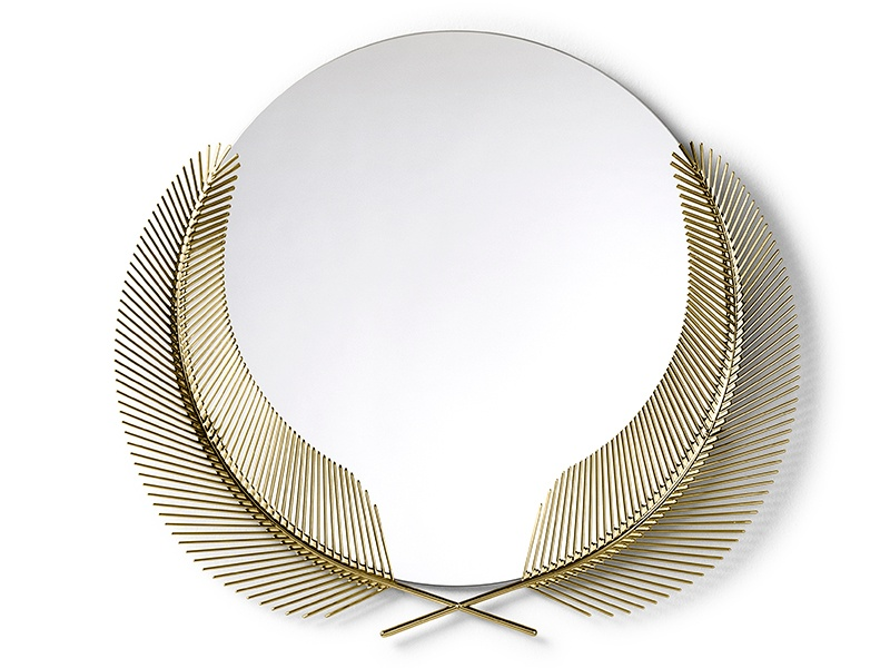"""Ghidini 1961's wall-mounted Sunset Mirror, a """"declaration of the true summer paradise scenario lingering just below the surface of the present moment,"""" features a 50-inch surface in the embrace of two polished-brass palm fronds."""