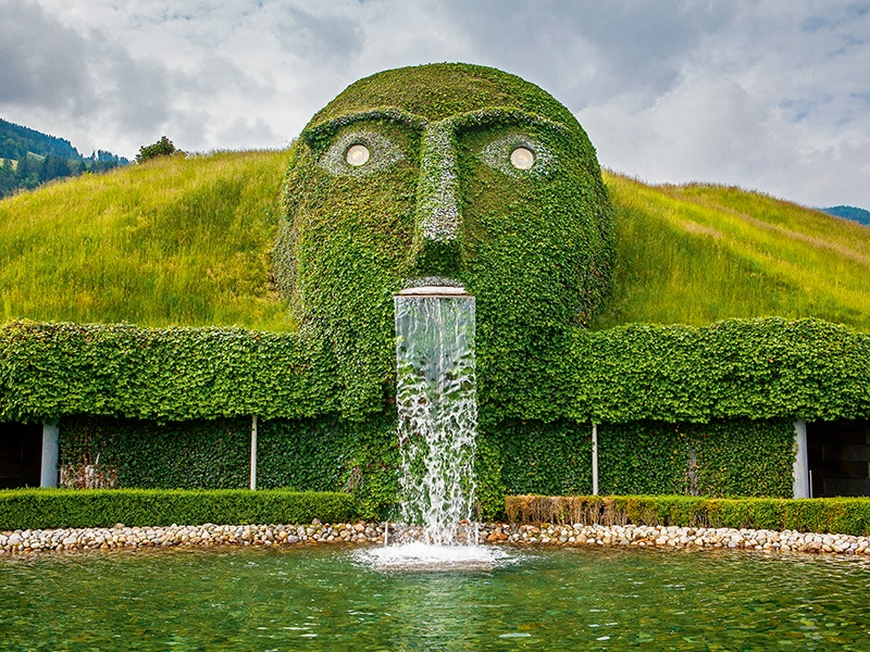 """Covered in moss, with crystal eyes, the """"Giant"""" is built into an Alpine hillside at the entrance to the Swarovski Crystal Worlds. Banner image: The Italian Water Garden, Longwood Gardens in Pennsylvania, USA. Photographs: Alamy"""