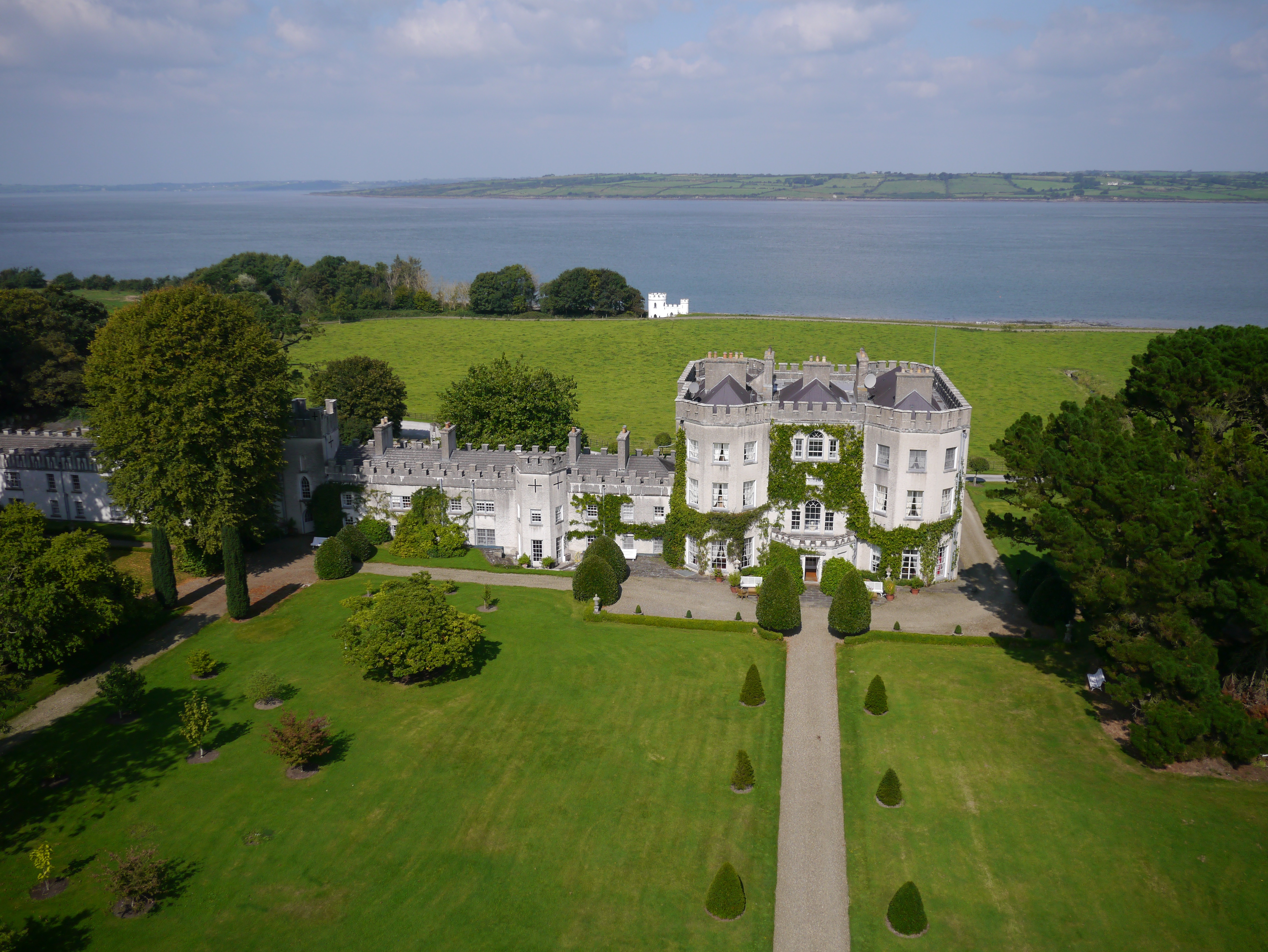 """Glin Castle, a """"castellated mansion,"""" is comprised of elements of original medieval architecture and later, Georgian style additions from the late 18th century."""
