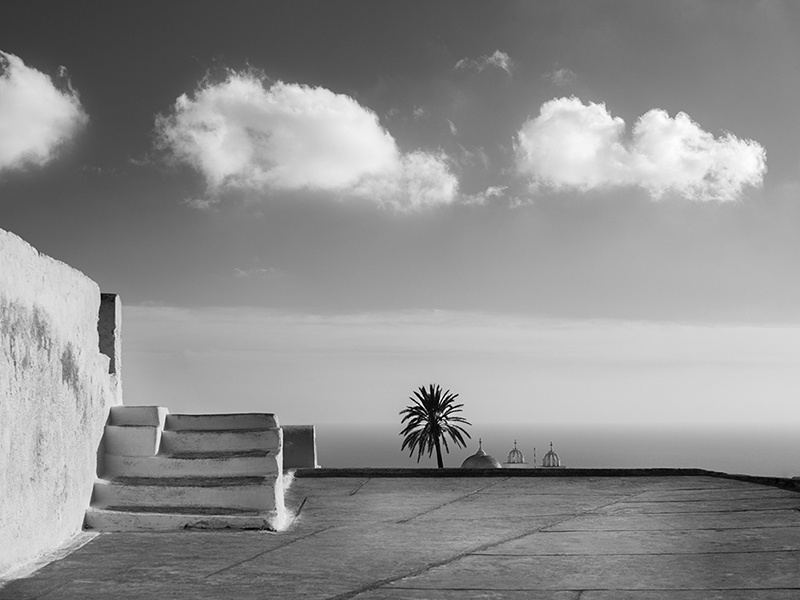 A black-and-white emphasis means clichéd images of Santorini's sunsets and the caldera are avoided. Photograph: Yiorgos Kordakis