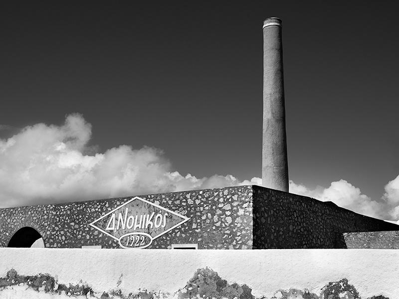 The iconic D Nomikos tomato canning factory in Vlychada, Santorini. Photograph: Yiorgos Kordakis