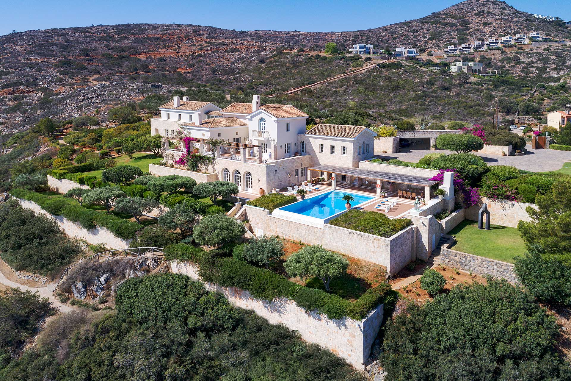 A jewel overlooking the Aegean Sea, this 6.58-acre estate on the island of Crete abounds with serene outdoor spaces, including a fragrant Mediterranean garden and a private beachside deck.
