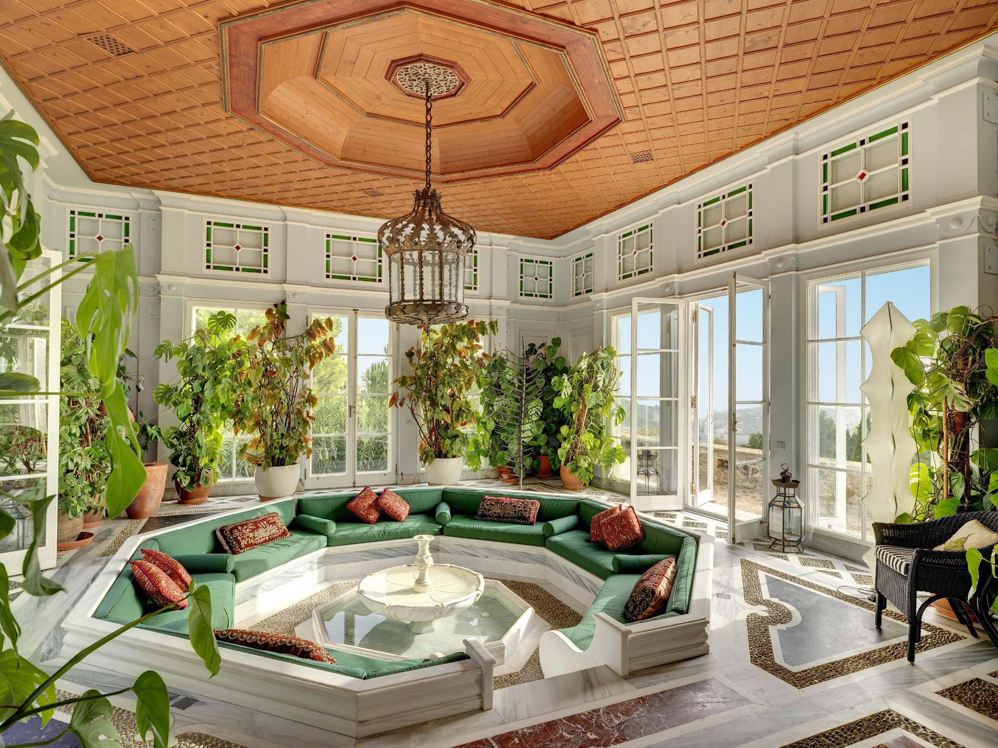 Every element of this Athenian estate exudes an atmosphere of luxury and style; among the home's myriad relaxation areas is a classically inspired sunroom with views over the outlying Mediterranean landscape.