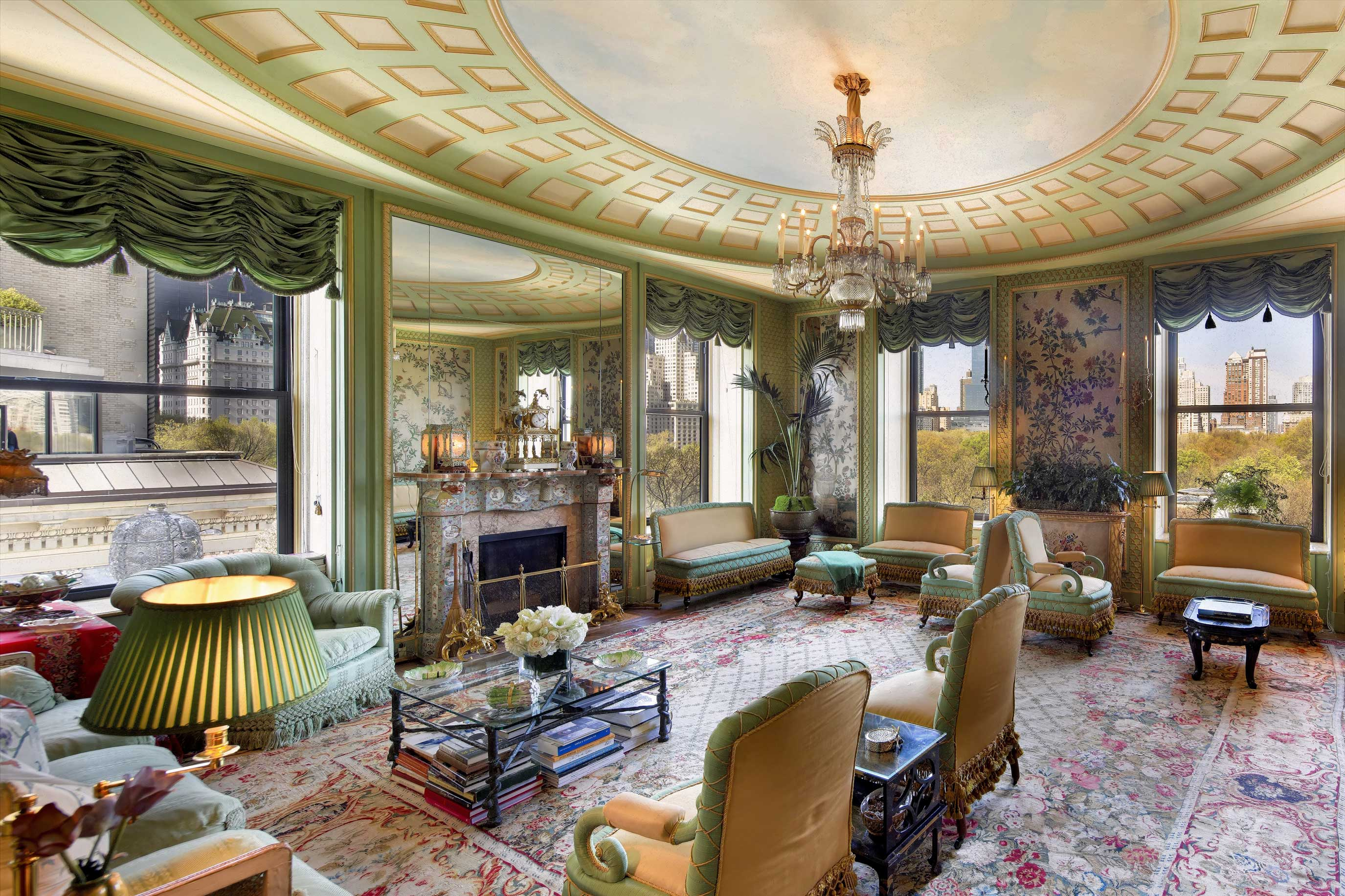 This luxury Fifth Avenue duplex is the creation of the celebrated New York architect Rosario Candela (1890–1953). A subtle shade of green sets the tone in the grand living room, which displays the architect's signature style: high, decorative ceilings, oversized windows, and ornate moldings.