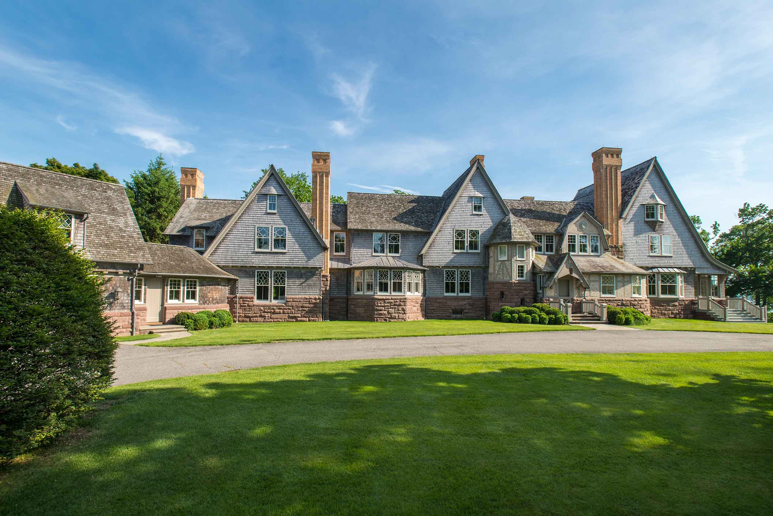 This centerpiece of this grand Belle Haven estate is a classic New England shingle-style mansion.