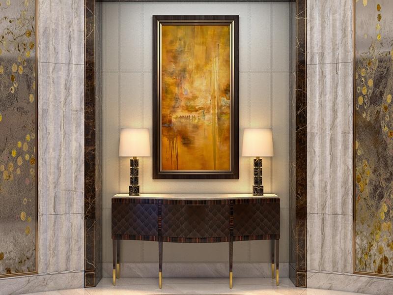 As lâmpadas gêmeas iluminam a arte com perfeição no saguão de entrada do mesmo apartamento em Pequim.  Foto: HBA Residencial