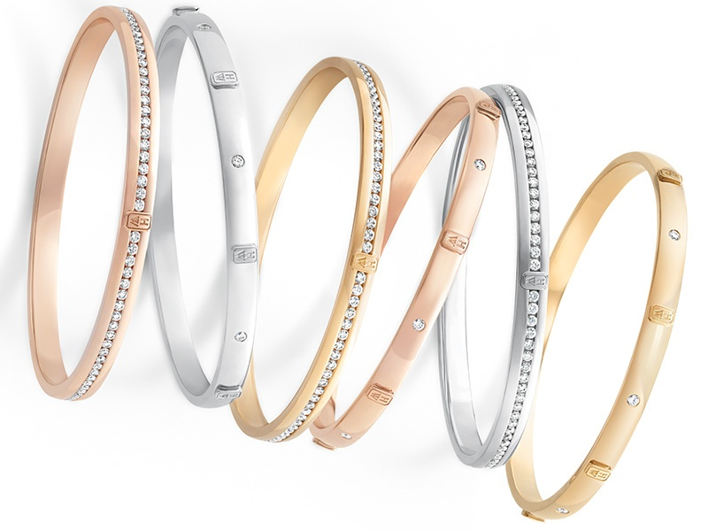 HW Logo Collection bangles, from Harry Winston, in 18-karat rose, white, and yellow gold.