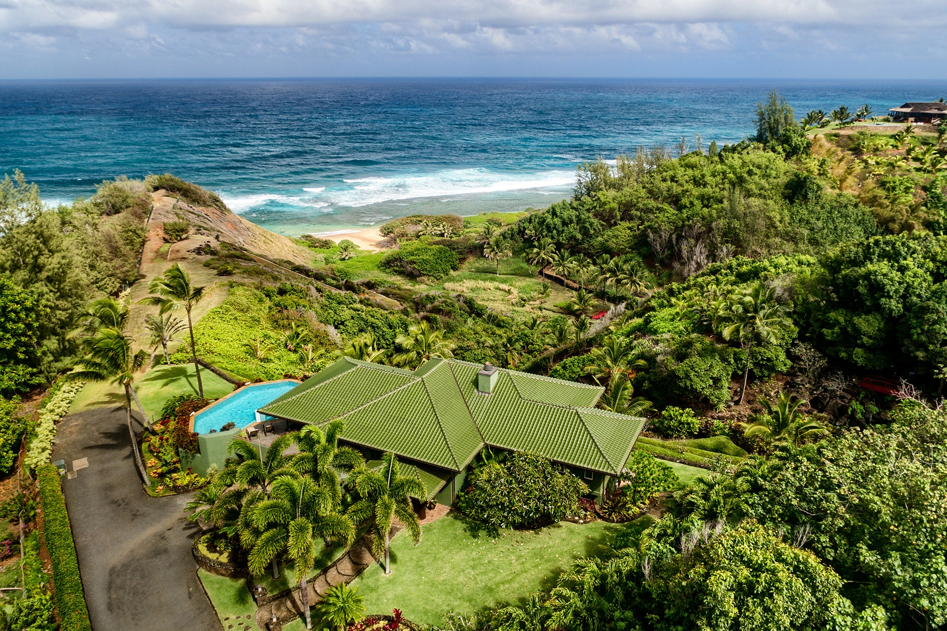 This lush estate enjoys a rare stretch of secluded beach on Kauai's cherished north shore.