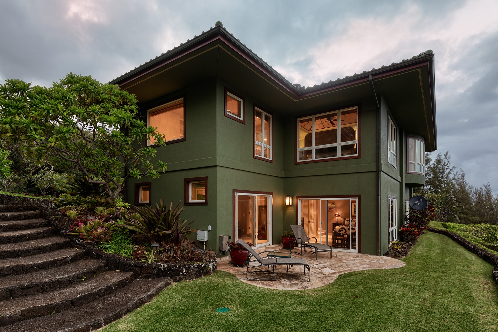 The charming main residence pays homage to Hawaii's colonial and Asian influence.