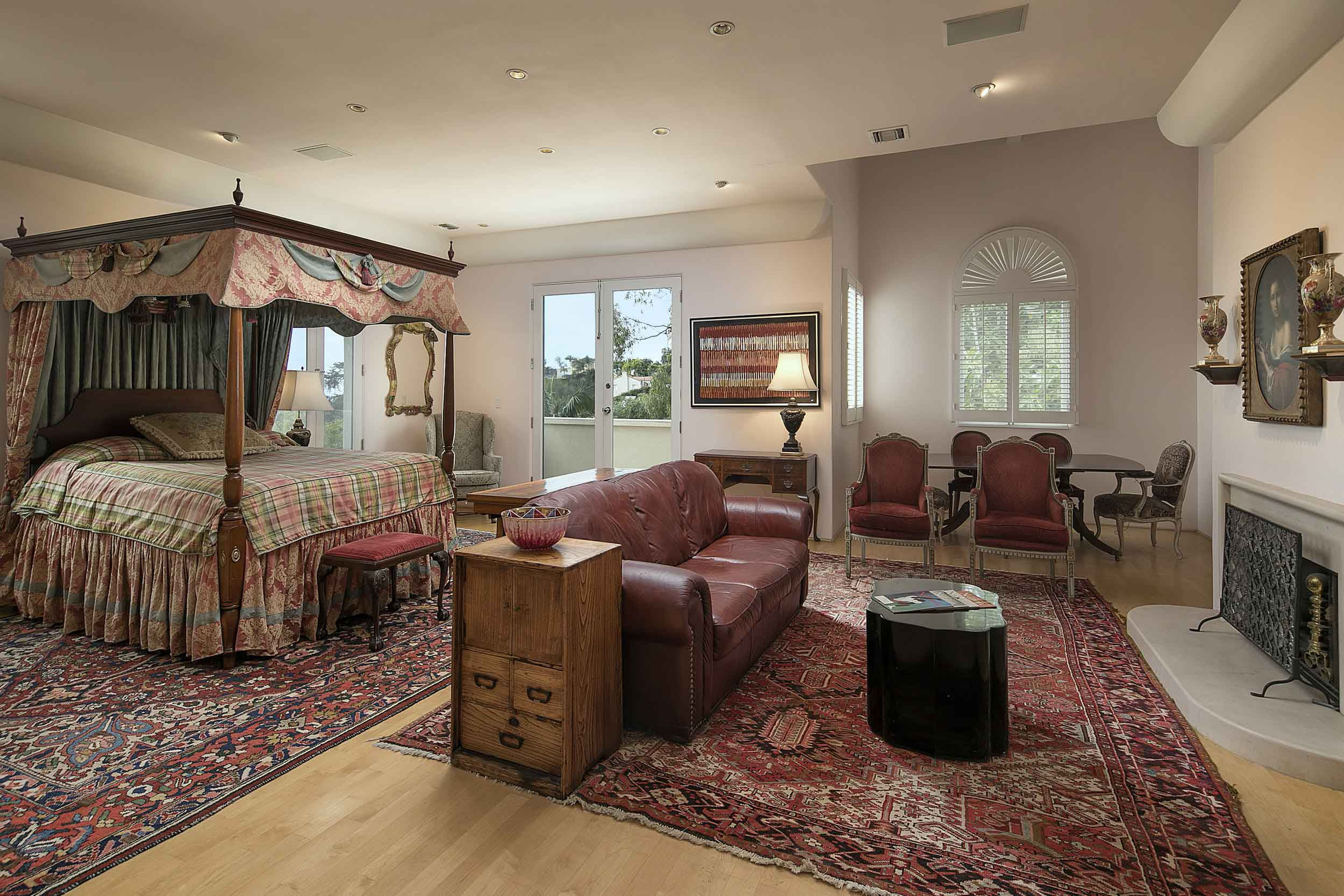 Vaulted ceilings and a welcoming hearth distinguish the home's generous master suite.