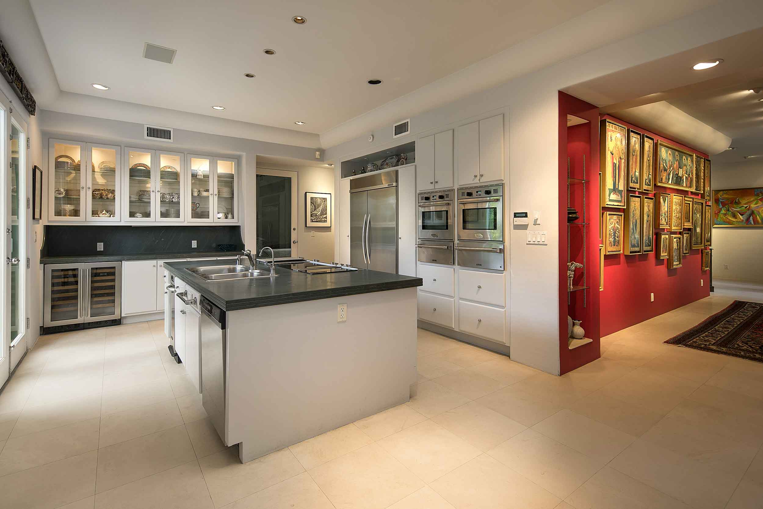 A newly modernized kitchen is a study in clean minimalism, with state of the art appliances and broad center island.