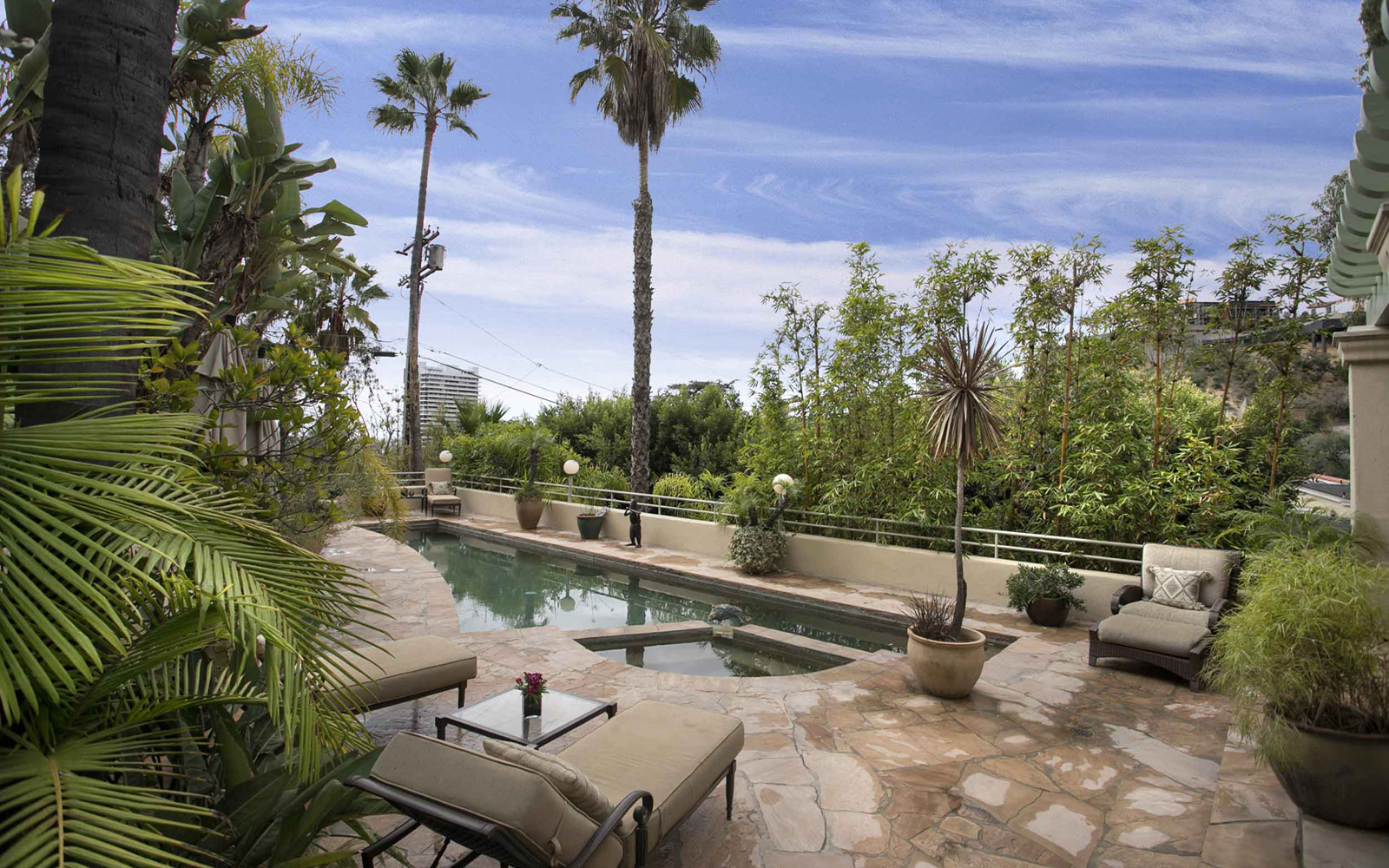 The home's outdoor areas include a patio surrounded not only by flagstone but by spectacular vistas—as well as a pool and private side yard.