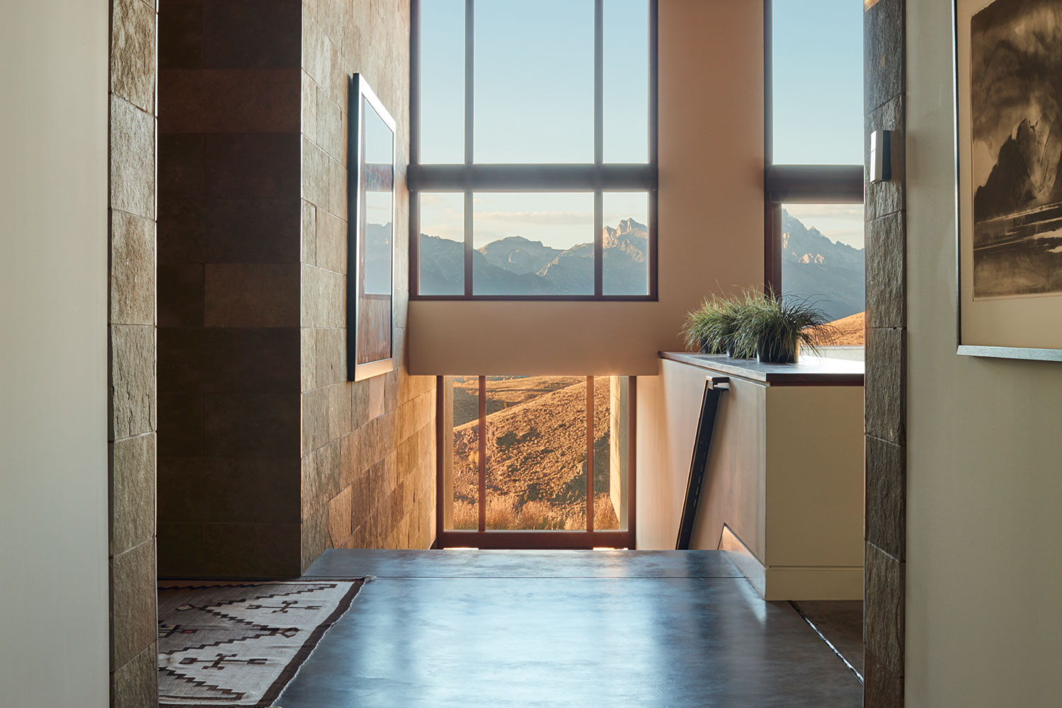 The rich tones of the cedar ceilings complement the stonework and polished concrete floors that feature throughout.