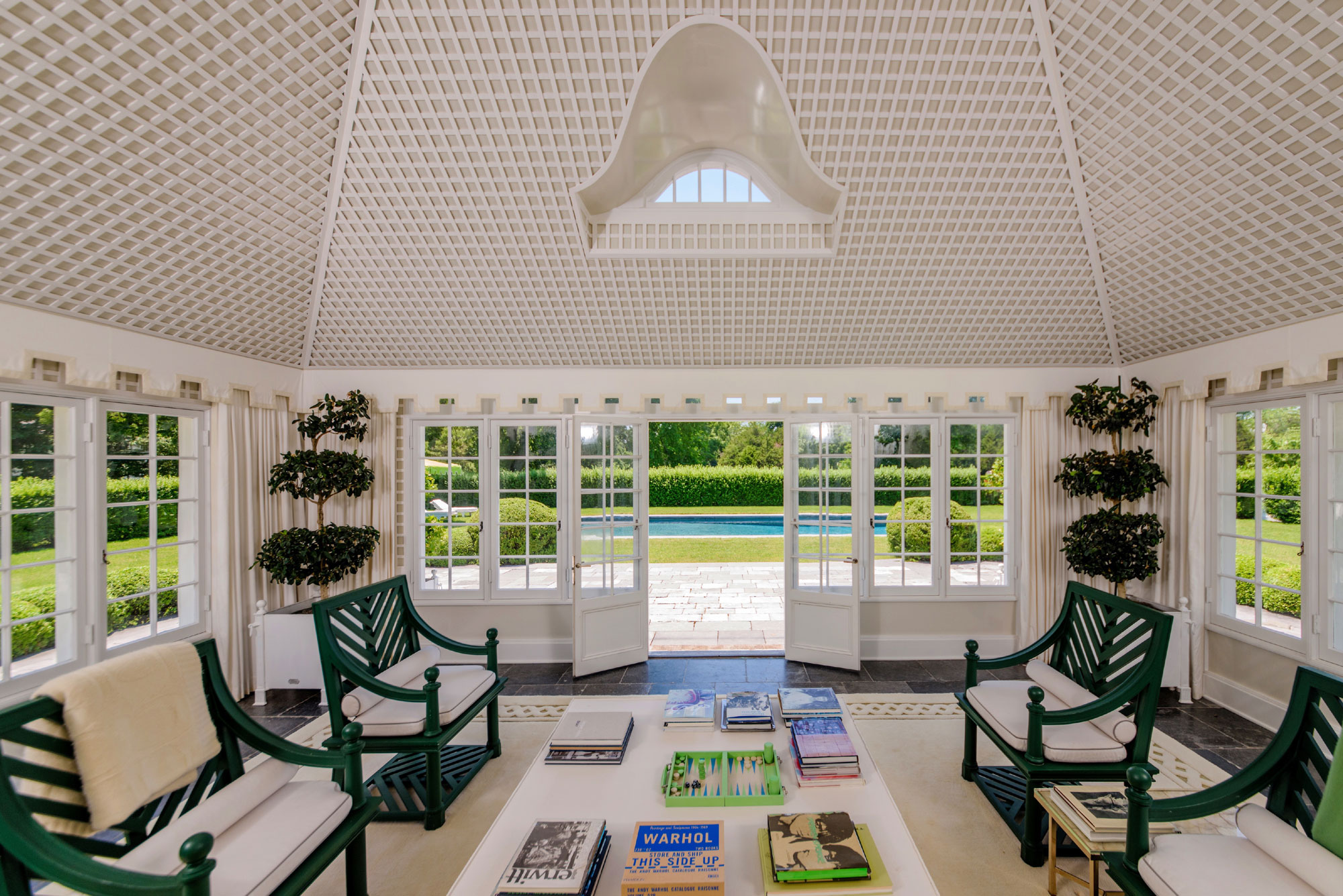 The childhood summer home of Jackie Kennedy, Lasata basks in its tranquil setting; the sunroom overlooks the idyllic grounds—the perfect space to dream of Camelot.