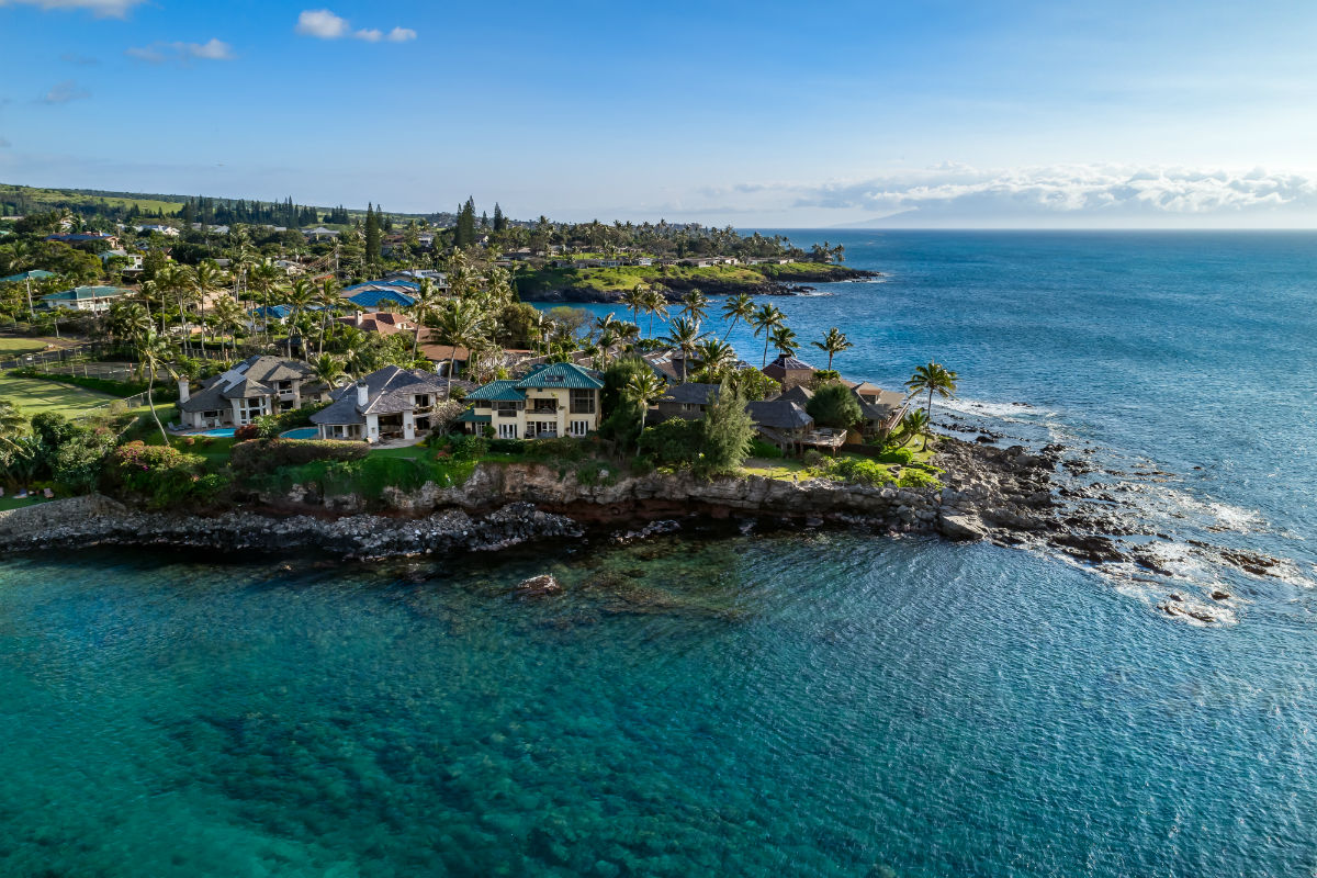 This oceanfront home captures the true spirit of Hawaiian living, with 360-degree Pacific Ocean views and a rock staircase leading down to a tranquil cove.