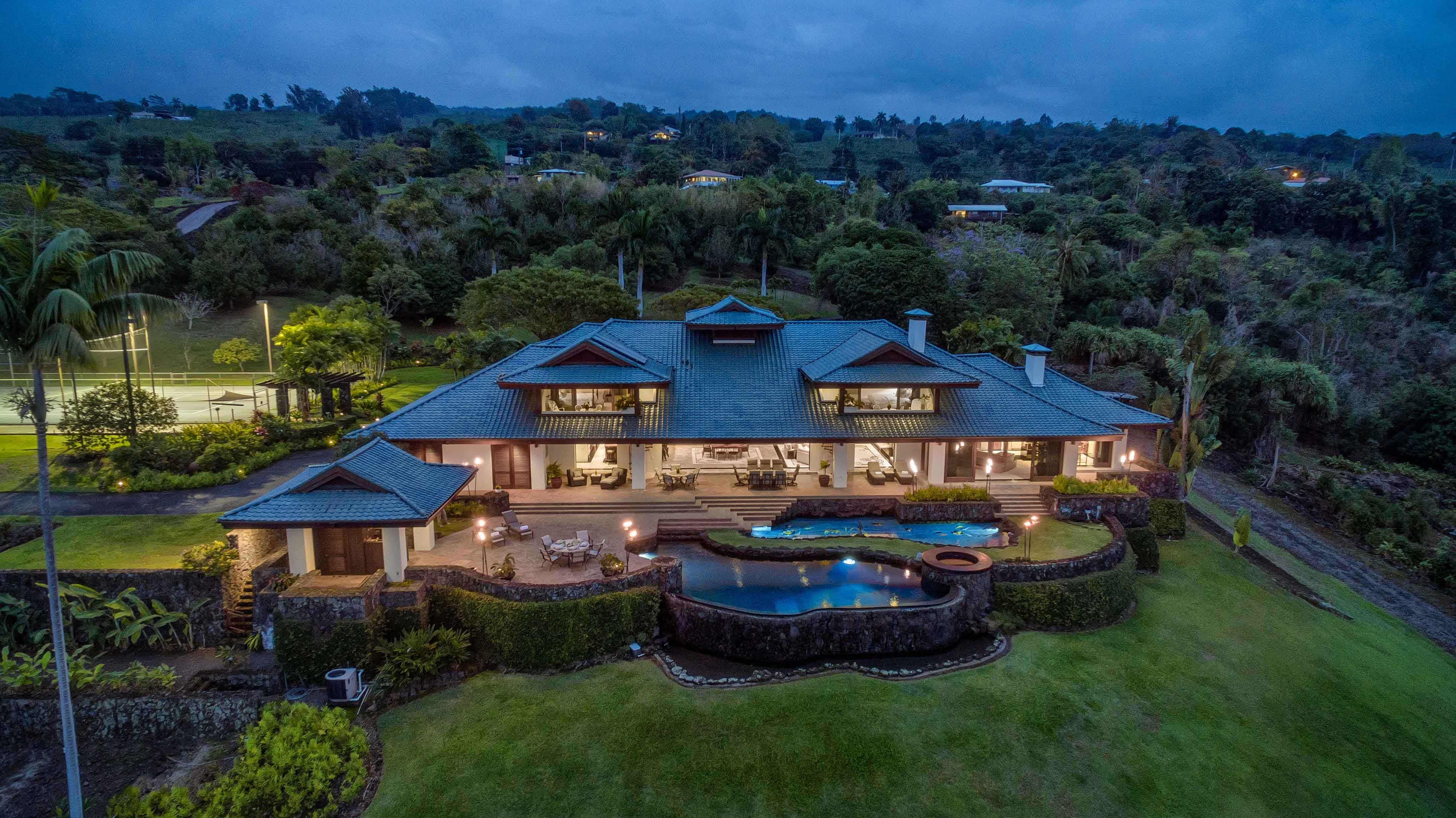 This private estate on Hawaii's Kona Coast has an alfresco dining terrace surrounded by Japanese-inspired botanical gardens with a koi pond, waterfalls, and exotic fruit and nut trees.
