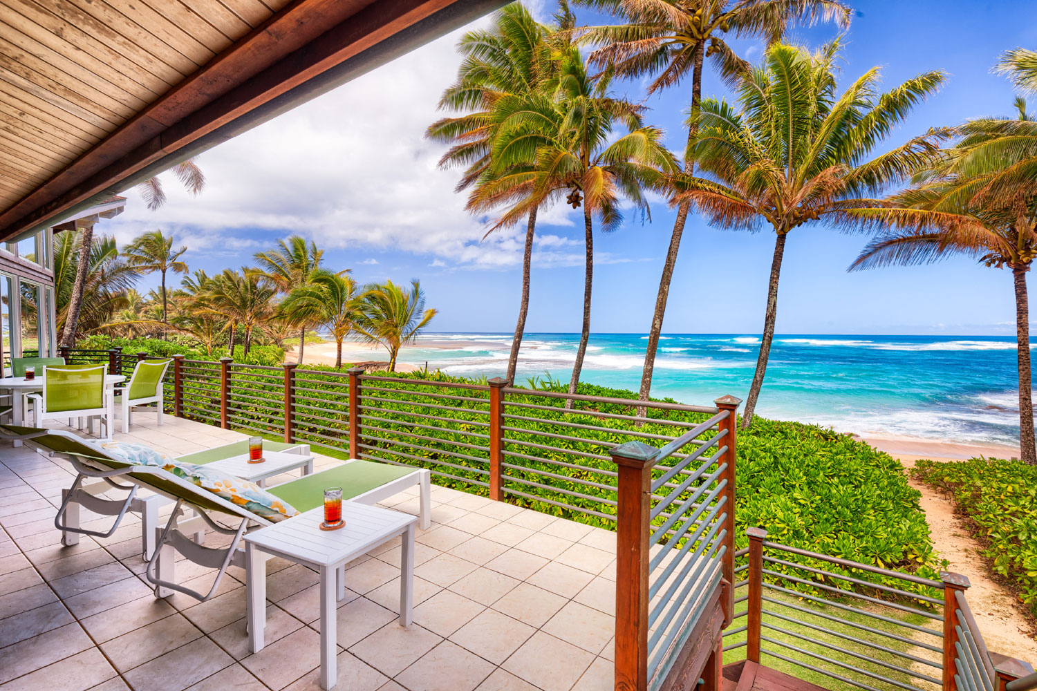 Set amid an acre of lush, tropical grounds, this sensational beachfront compound sits on a pristine stretch of sandy beach overlooking Hanelei Bay on the exclusive North Shore of Kauai.
