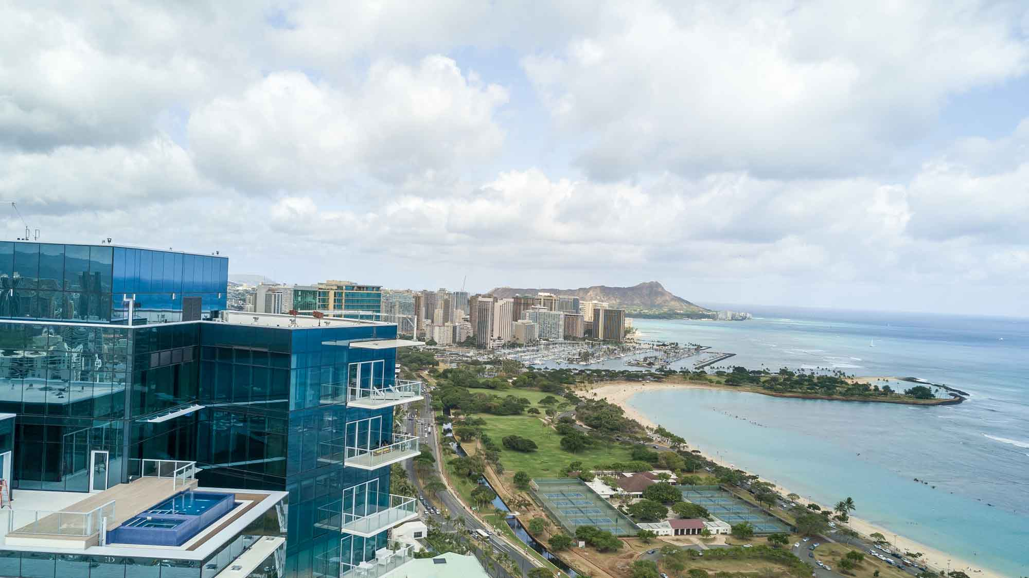 Cinematic vistas of Diamond Head, Waikiki, and Honolulu Harbor area a hallmark of this exclusive Waiea Tower penthouse.