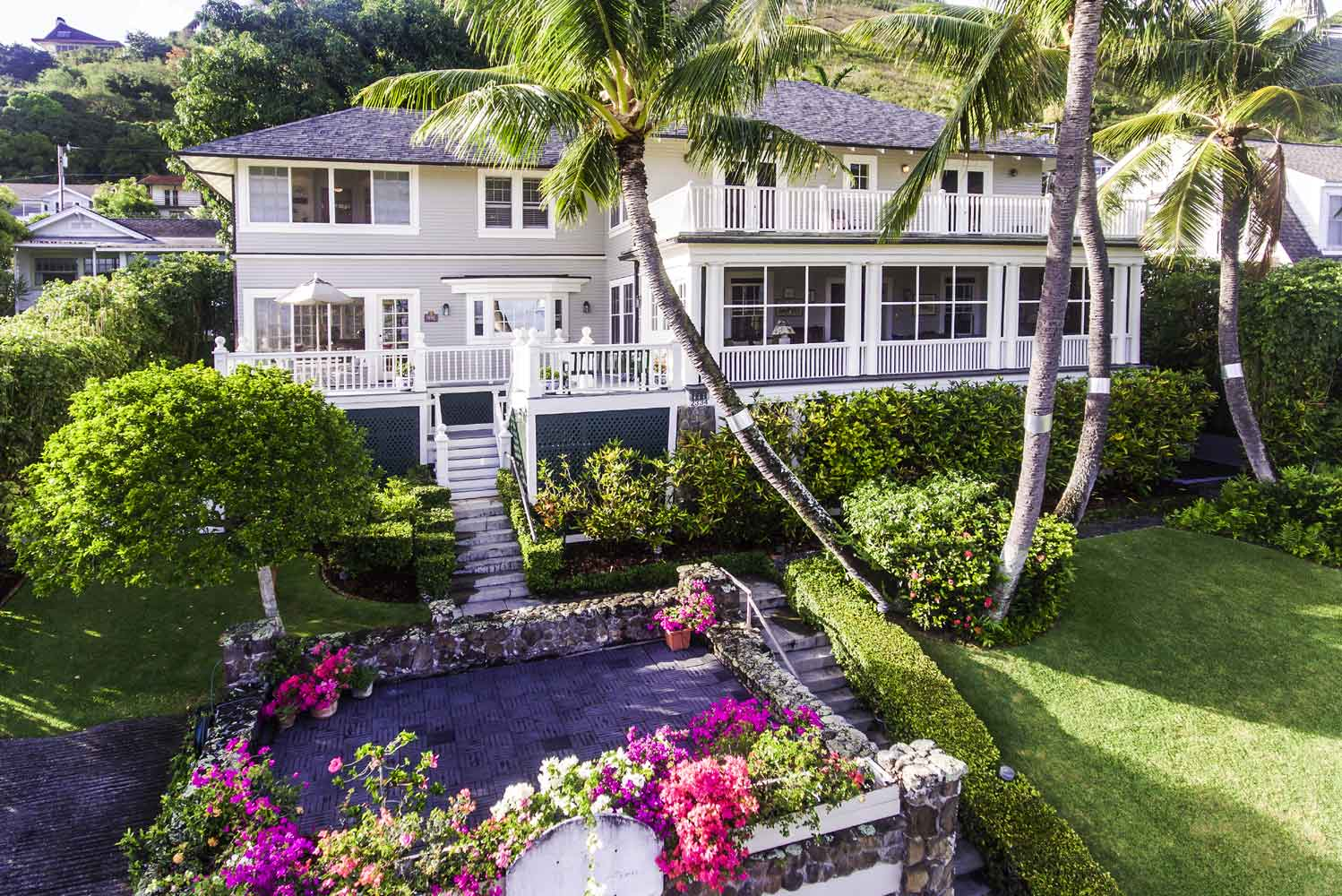 With breathtaking views of Diamond Head and the Pacific Ocean, this six-bedroom, 4,304-square-foot Colonial Revival Craftsman house in Manoa will entertain residents and their guests in grand Hawaiian style.