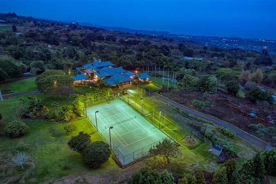 This spectacular estate on 90 acres in Kailua-Kona has beach access, beautiful grounds for walking and hiking, and an array of sporting amenities including a tennis court, driving range, and bocce court.