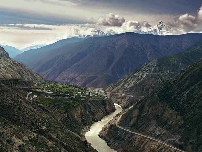 Stunning Himalayan mountain vistas surround Moët Hennessey's Ao Yun winery, in China's Yunnan province. Photograph: Juan Hitters.